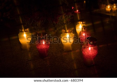 Candles on a cementary at night in All Saints Day in Poland - stock photo