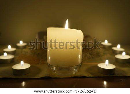 Candles on altar, selective focus on the candle, night candlelight time - stock photo