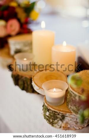 candles on birch tree cut - stock photo
