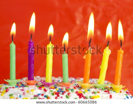 candles on birthday cake - stock photo