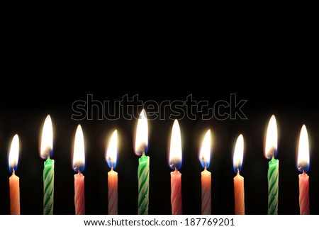 candles on black background - stock photo