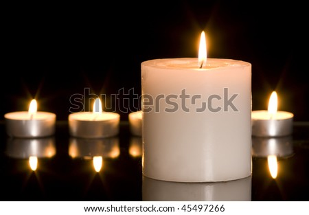 Candles on black background with large copy space.