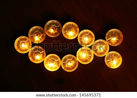 Candles on dark wooden background - stock photo