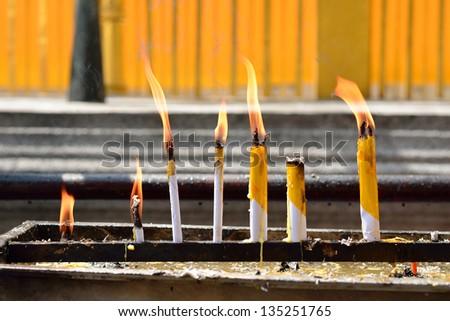 candles prayer buddha shrine - stock photo