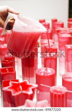 Candles produce by hand in a small company - stock photo