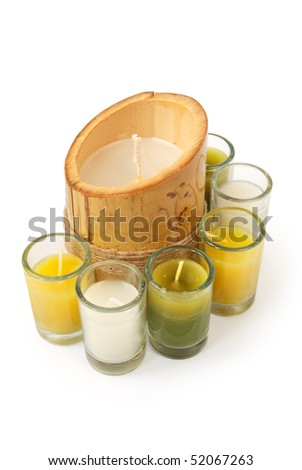 Candles with some in glasses isolated on white - stock photo