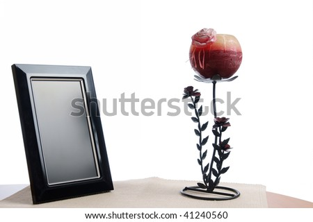 candlestick and photo frame on the table in white background - stock photo