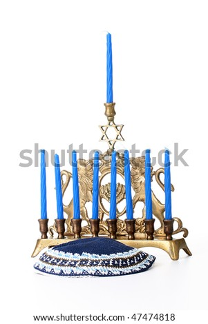 Candlestick for nine candles with candles and skullcap in Judaic religion. - stock photo