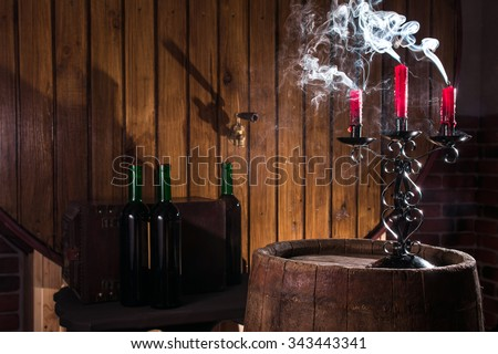 Candlestick on wine barrel