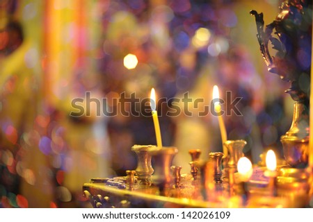 Candlestick with burning candles in  Orthodox church. - stock photo