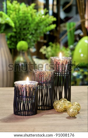 candlestick with flowers on the table - stock photo