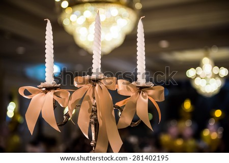 candlesticks with candles in ballroom