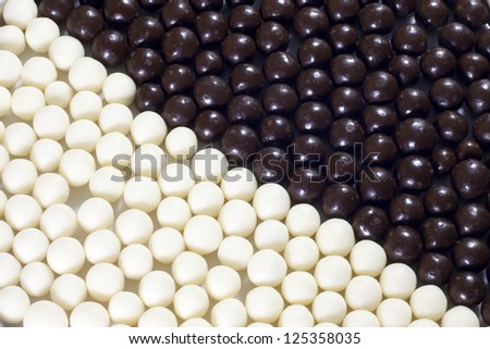 Candy black and white balls background - stock photo