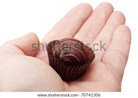 Candy cane from the gift set in a man's palm. - stock photo