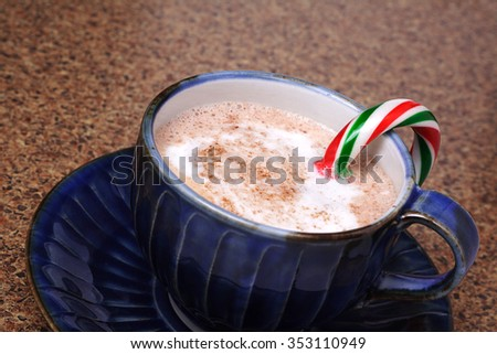 Candy cane melting in a mug of hot chocolate with selective focus on cane - stock photo