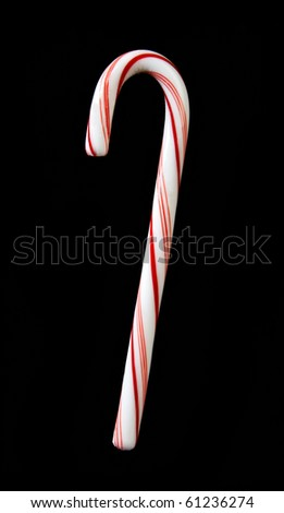 Candy cane on black background isolated for your next project - stock photo