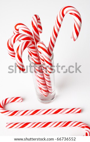 candy cane on glass - stock photo