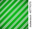 Candy cane patterned paper in green and white backlit. - stock photo