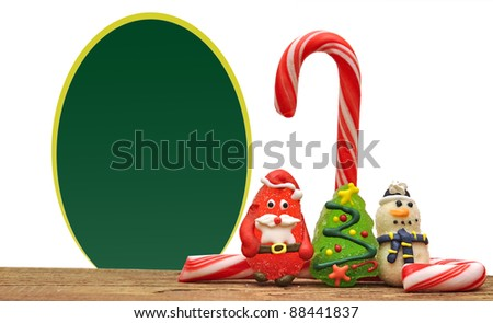 Candy canes and christmas toys over white