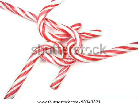 Candy canes hooked together - stock photo