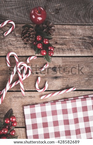 candy canes on a wooden background