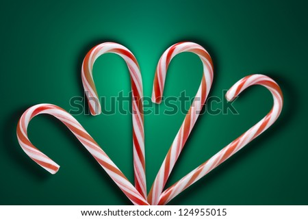 Candy canes on green background