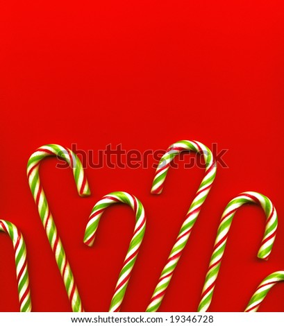 candy canes on red background - stock photo