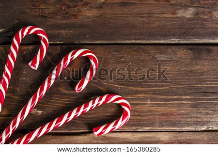 candy canes on wooden boards - stock photo