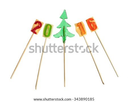 Candy christmas tree and 2016 year number lollipops isolated over white - stock photo