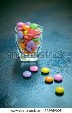 Candy colors in the glass of vintage style. - stock photo
