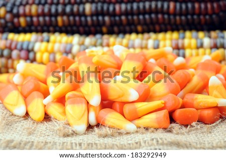 candy corn and Indiana corn on table - stock photo