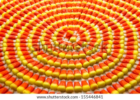 Candy corn arranged in circles - stock photo