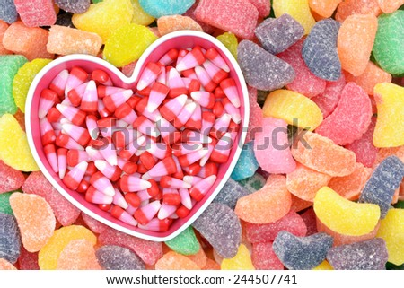 candy corn in heart shape bowl for Valentine Day - stock photo