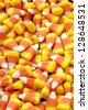 Candy corn is a popular halloween candy. - stock photo