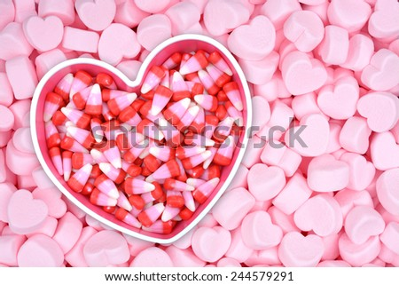 candy corn on pink marshmallow for Valentine Day - stock photo