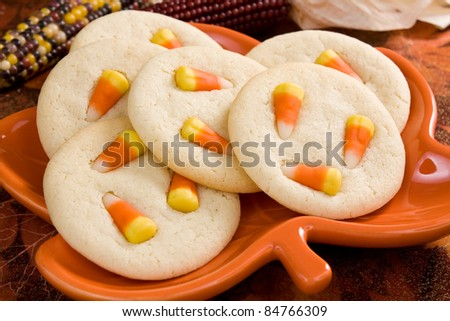 Candy Corn Sugar Cookies - Sugar cookies topped with festive fall candy corn for Halloween or Thanksgiving. - stock photo