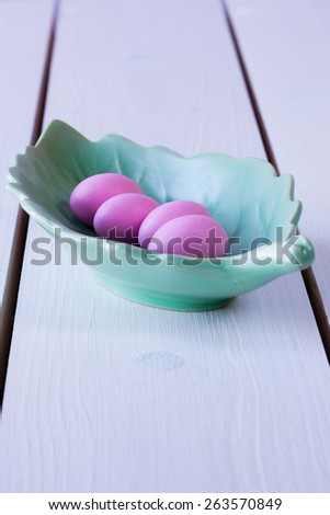 candy eggs in a plate shaped as a leaf - stock photo