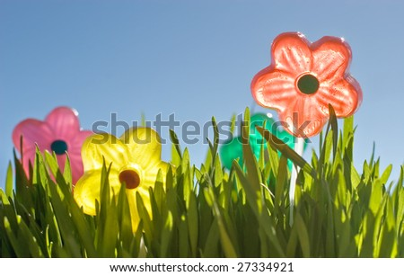candy flowers in the grass - stock photo