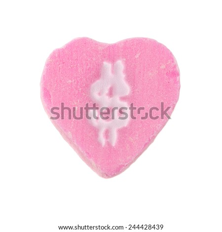 Candy Heart Dollar Sign. Pink candy heart with dollar sign symbol printed on it. Valentine's Day concept. - stock photo