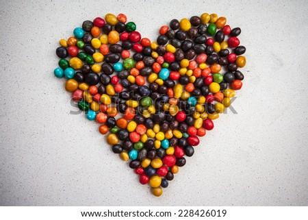 candy heart multicolored pebbles stone sweet chocolate raisins glaze  - stock photo