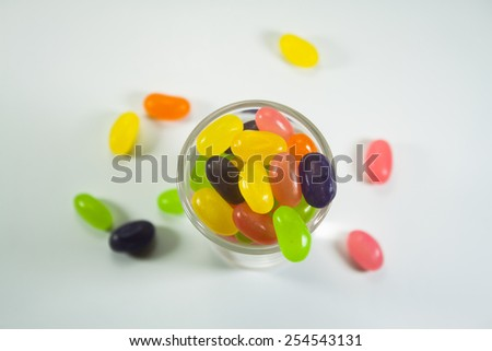 Candy in a glass on a white background. - stock photo