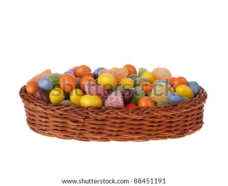 Candy in basket,  isolated on white