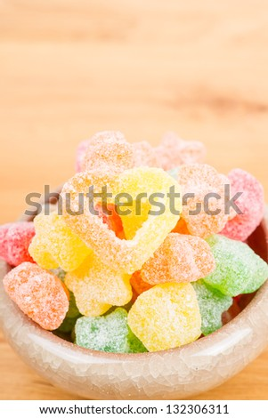 candy in bowl on the table - stock photo