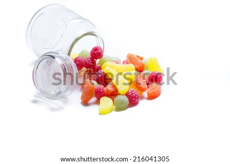 candy in glass jar isolated on white - stock photo
