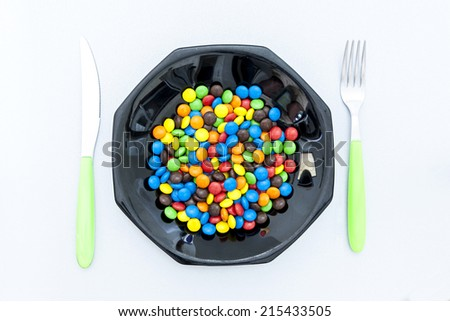 candy in the black dish for dinner - stock photo