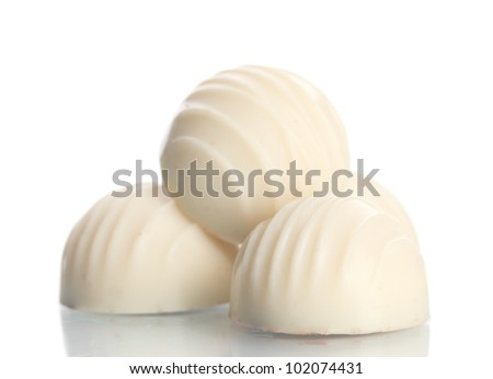 Candy in white chocolate isolated on white - stock photo