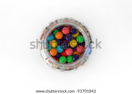 Candy jar full of colorful candy - top view - stock photo