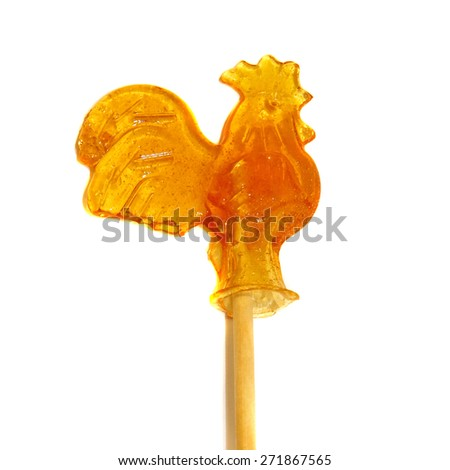Candy of burnt sugar - cockerel on a stick isolated - stock photo