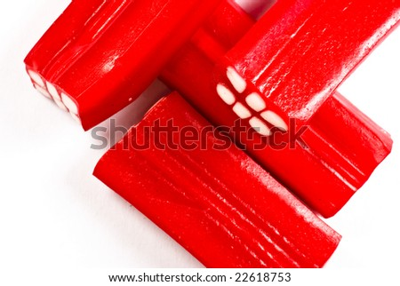 candy red bricks on white background - stock photo