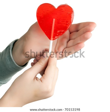 candy red heart in the hands of a white background
